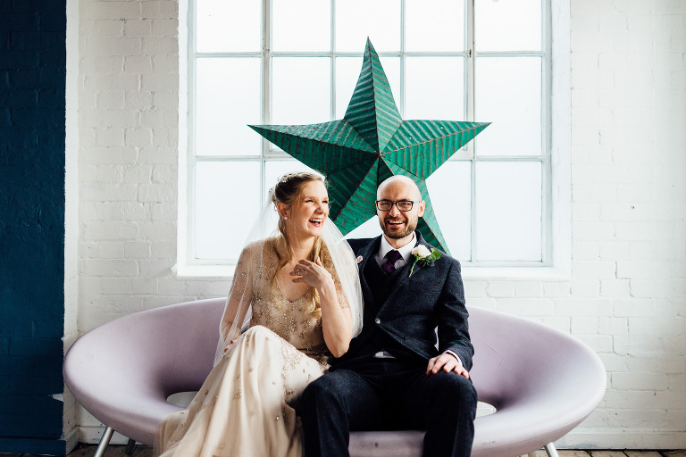 BRIDE AND GROOM AUTUMN WEDDING AT ONE FRIENDLY PLACE COUPLES PORTRAITS WITH PROPS AND DECORATION ROOFTOP OF WAREHOUSE WEDDING IN LONDON