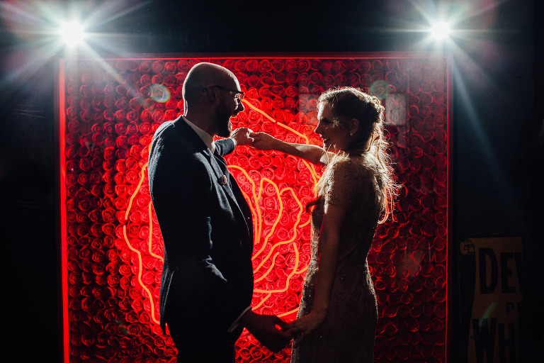DANCE CANDIDS AT WAREHOUSE WEDDING AT ONE FRIENDLY PLACE LONDON DOCUMENTARY FUN WEDDING PHOTOGRAPHY NEON ROSE